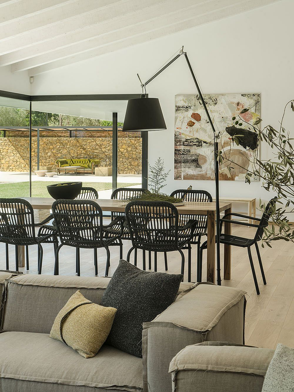 Dining room with dark dining tables and floor lamp