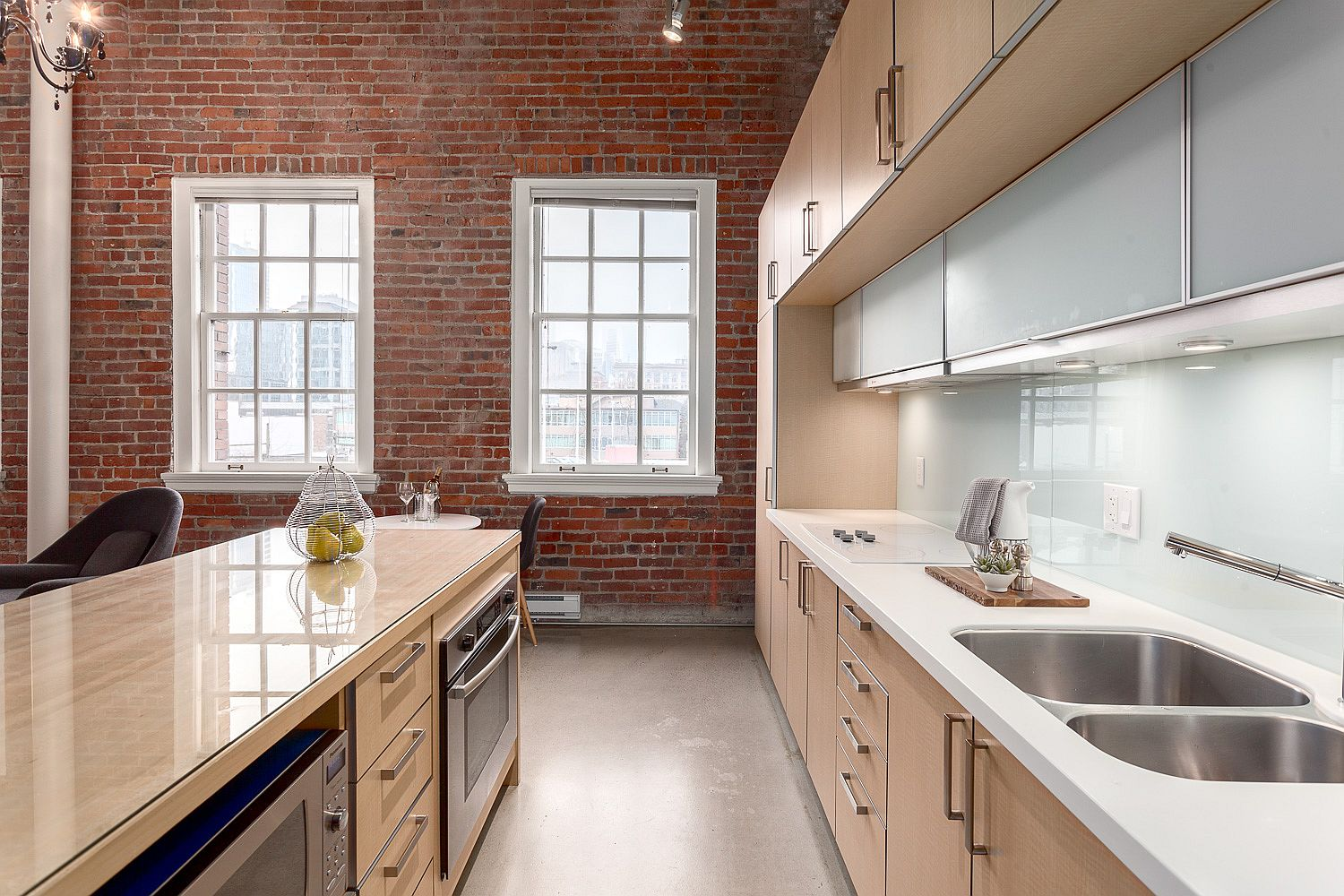 Exposed brick wall also gives the kitchen a fabulous modern-industrial look