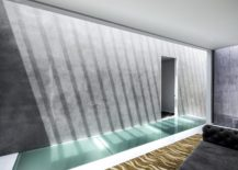 Exposed-concrete-finishes-give-the-interior-a-stoic-minimal-look-217x155