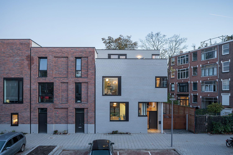 Exterior-of-the-home-in-plain-white-bricks-and-lovely-framed-windows