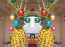 Festive-baubles-on-a-pineapple-make-for-a-fun-Christmas-tree-alternative-217x155