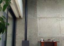 Fireplace-in-the-corner-next-to-the-accent-concrete-wall-217x155