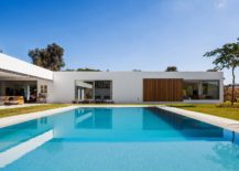 Floor-to-ceiling-windows-and-an-open-deisgn-connect-the-interior-with-the-pool-area-217x155