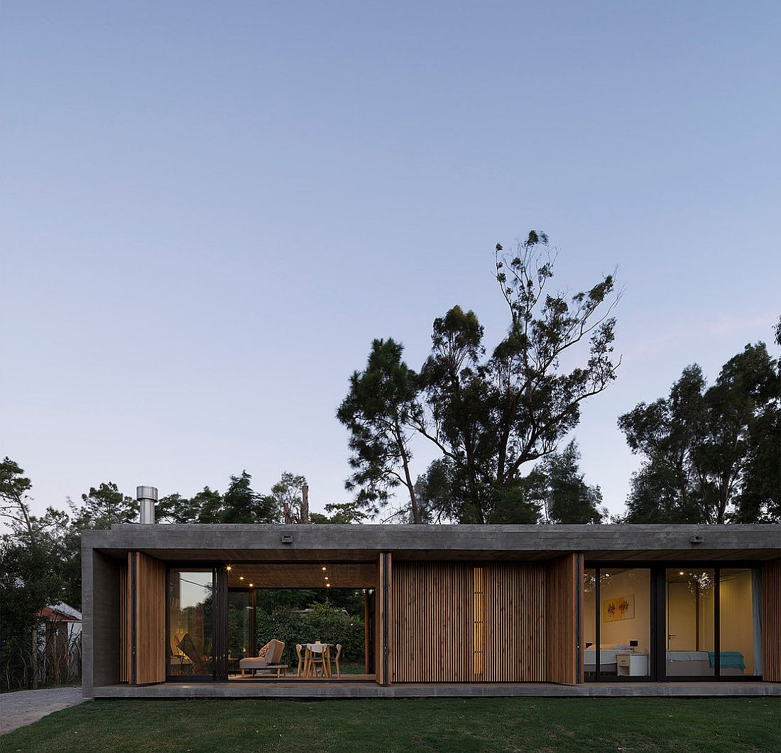 Folding-doors-with-wooden-slats-open-up-to-connect-the-interior-with-outdoors
