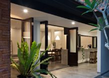 Folding-glass-doors-connect-the-garden-with-the-interior-217x155