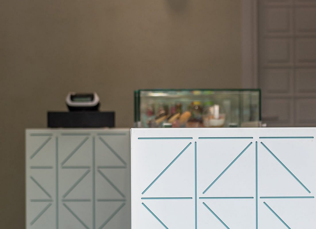 Geo pattern on the counter gives the sweet shop a trendy, modern look