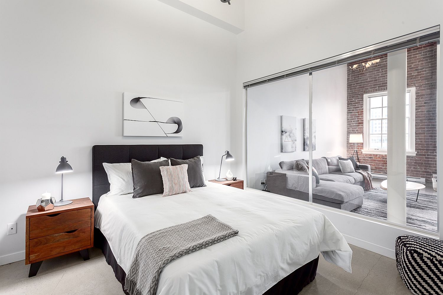 Glass windows connect the bedroom with the living area