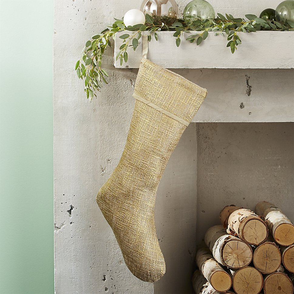 Gold stocking on a holiday mantel