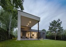 Gray-and-elegant-exterior-of-the-home-along-with-a-lovely-garden-217x155