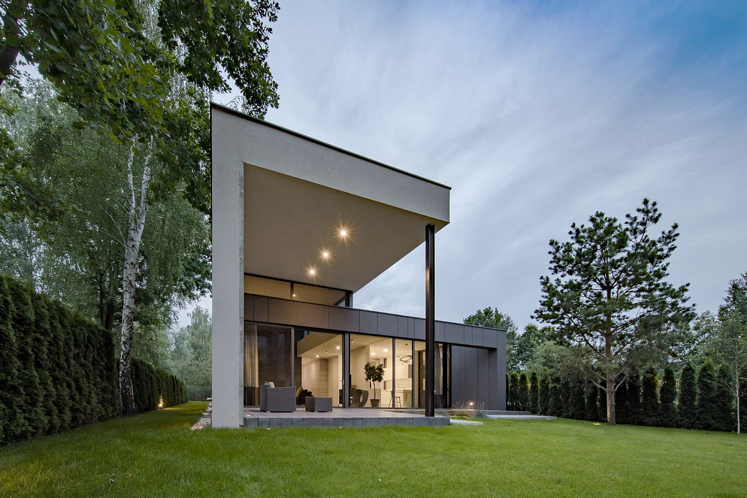 Gray-and-elegant-exterior-of-the-home-along-with-a-lovely-garden