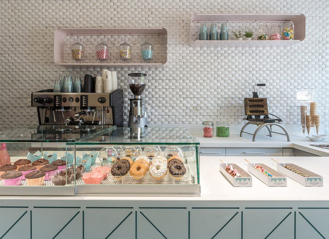 Handmade waffles, cookies and cupcakes and doughnuts on display at Pop Sugar