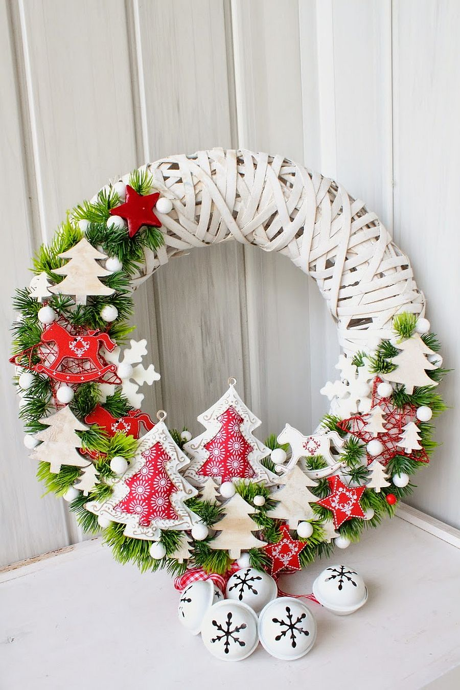 Incorporate winter motifs into the basic wreath for a Christmassy feel