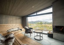 Interior-of-the-cabin-with-lovely-seating-that-offers-a-view-of-the-landscape-beyond-217x155