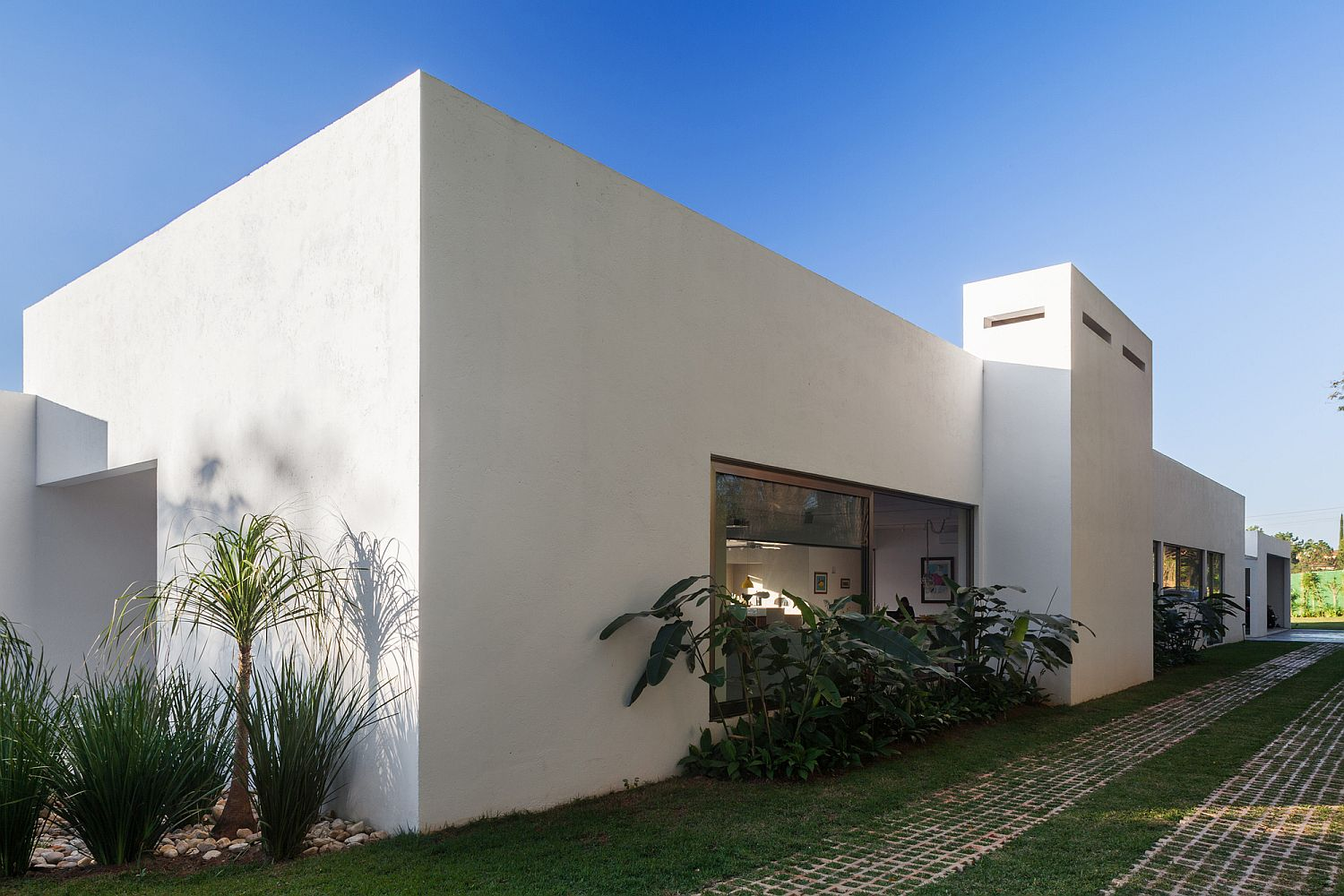 L-Shaped design of the family offers privacy within the central courtyard