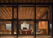 Large-glass-windows-and-doors-open-up-the-interior-to-the-forest-outside-217x155