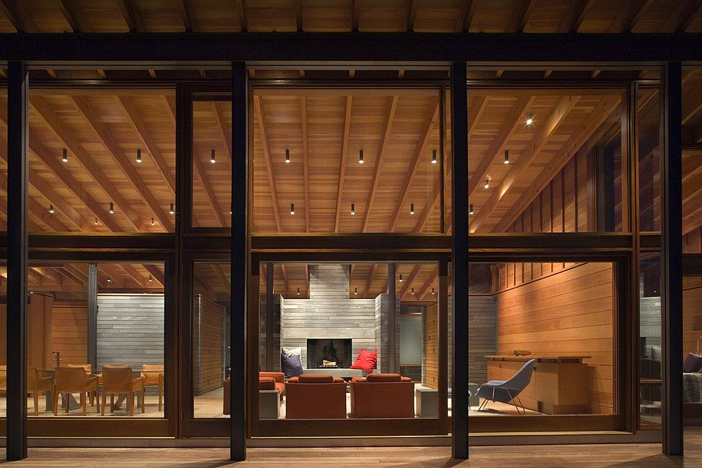 Large-glass-windows-and-doors-open-up-the-interior-to-the-forest-outside