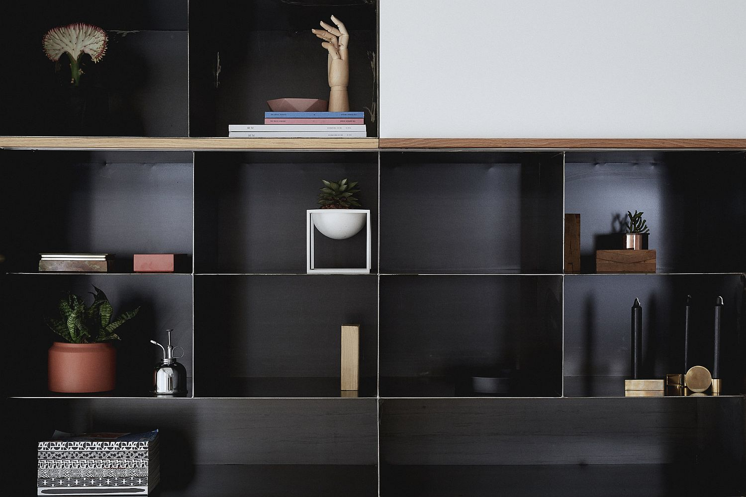 Living room entertainment unit brings a touch of black to the living space