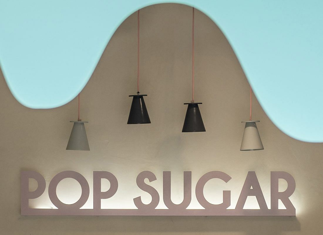 Melting-Chocolate-inspired-facade-of-the-shop-in-blue-stands-in-contrast-to-the-neutral-interior