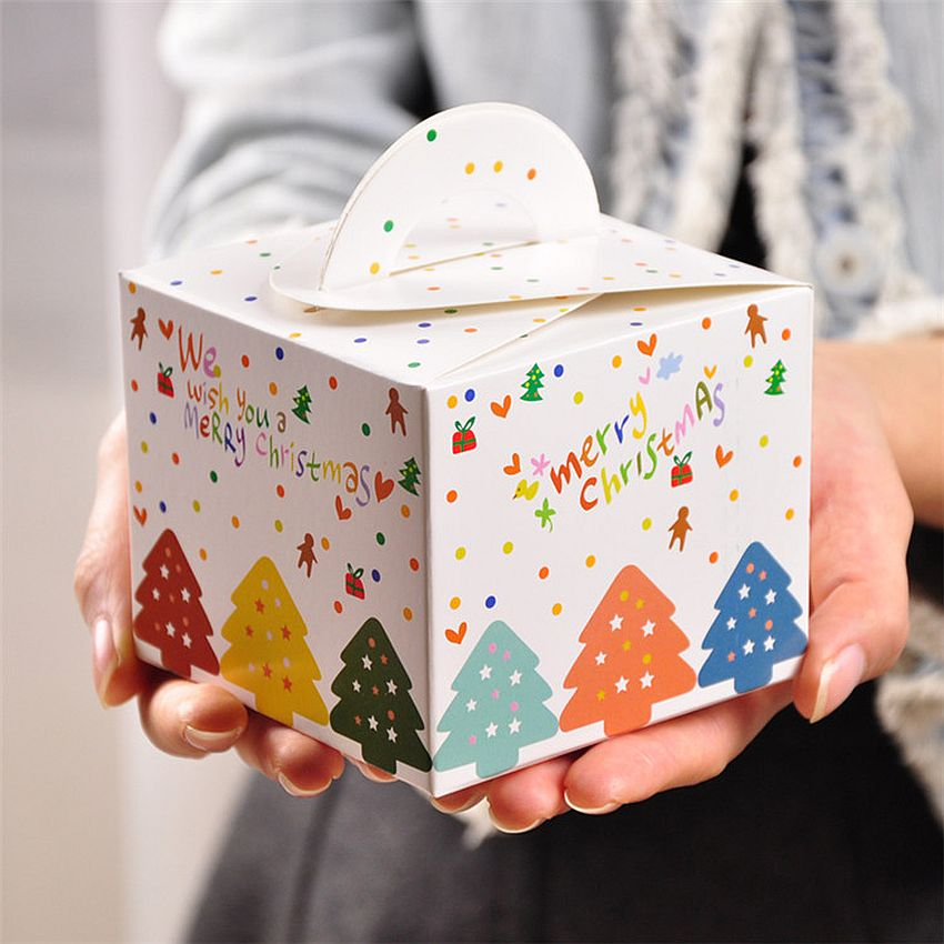White Christmas gift box with holiday decorations