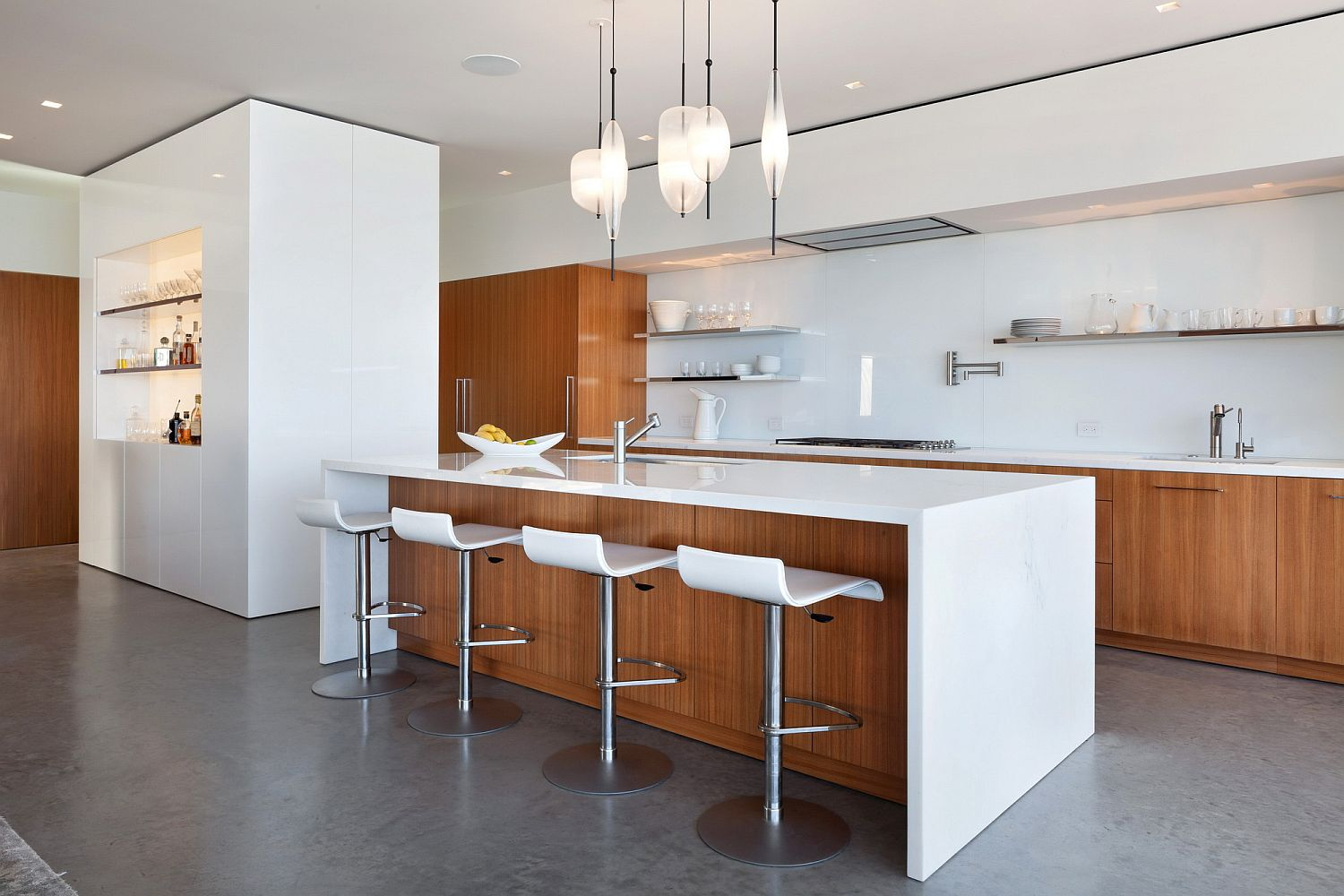 Modern kitchen in wood and white with slim bar stools and floating glass shelves