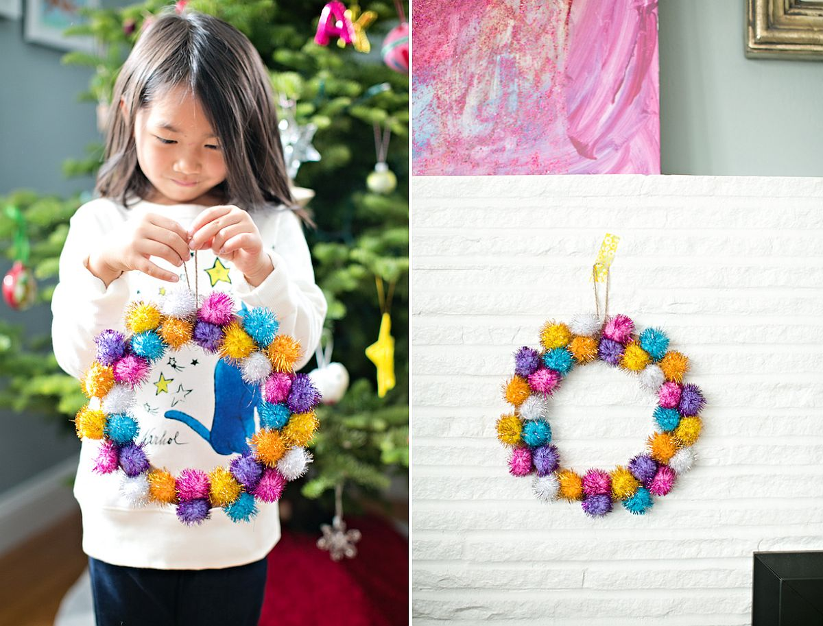 Multi-colored DIY wreath made with pom poms