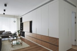 Wood and Steel Entertainment Unit Becomes the Highlight of This Israeli Home