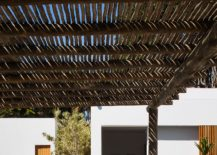 Natural-pergola-structure-offers-shade-from-midday-sun-217x155