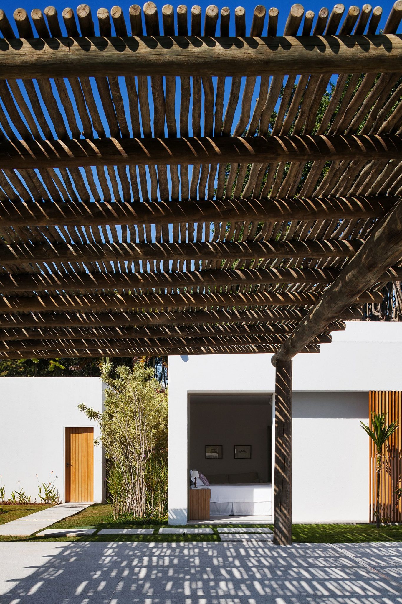 Natural pergola structure offers shade from midday sun