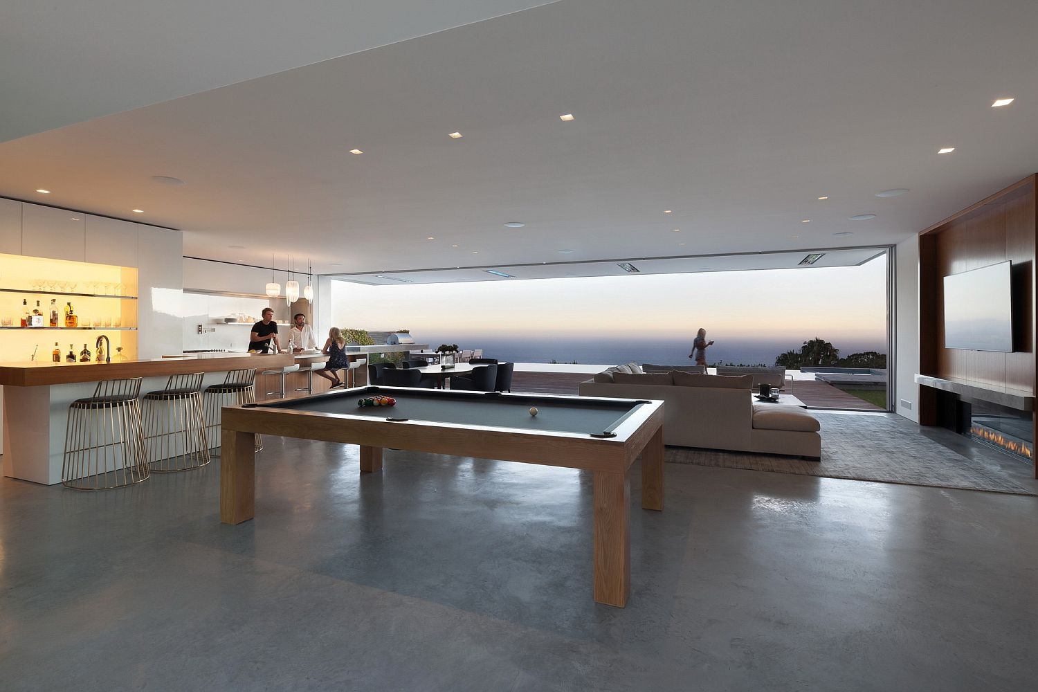 Open living area, kitchen and dining room with Pacific Ocean views