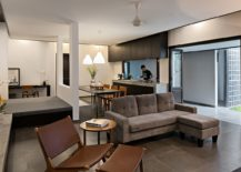 Open-plan-living-area-with-smart-workspace-and-kitchen-in-the-corner-217x155