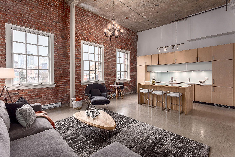 Original restored brick and classical windows inside the apartment