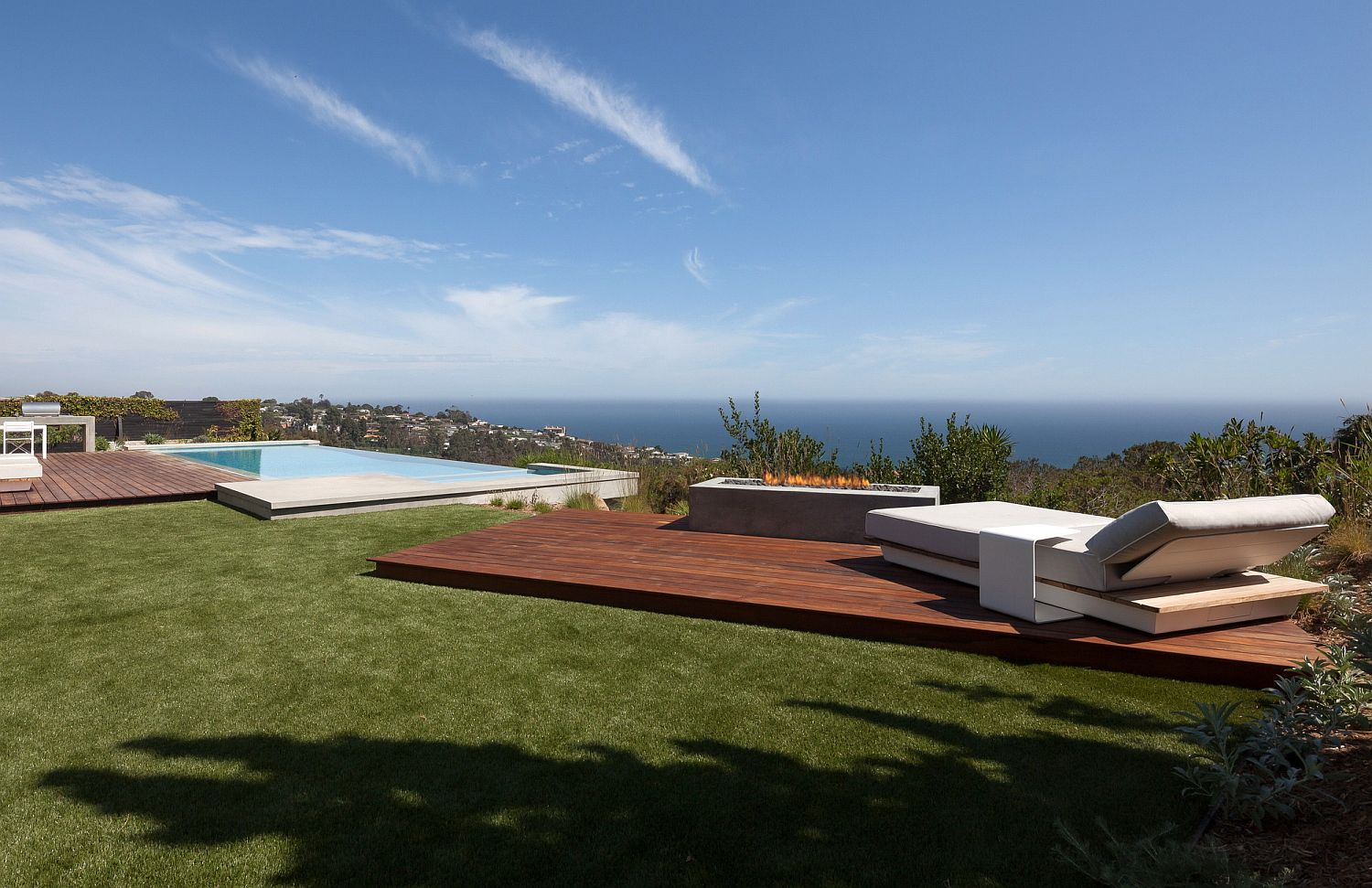 Outdoor hangout with firepit, wooden deck, infinity pool and awesome Pacific Ocean views