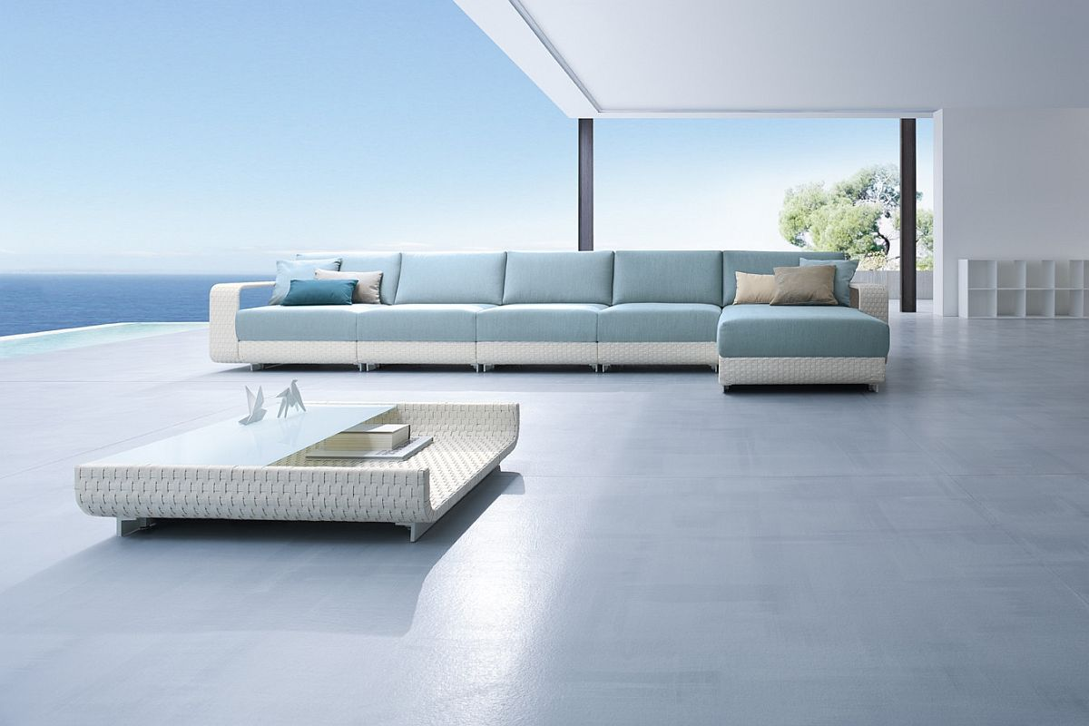 Outdoor sofa in light blue along with a low-slung coffee table