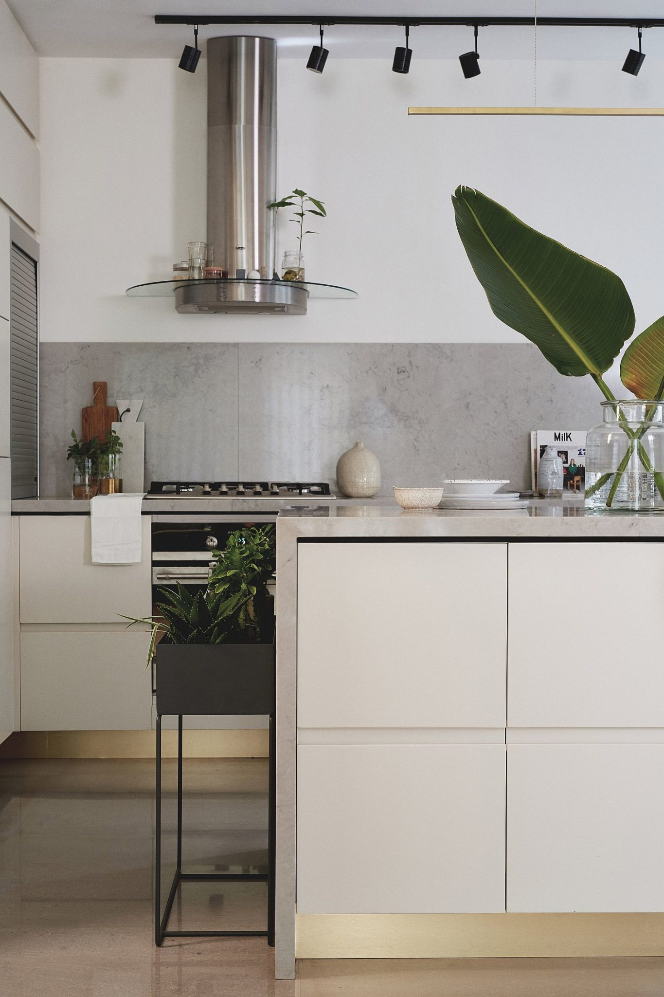 Polished edges of the kitchen with metal shelves and surfaces