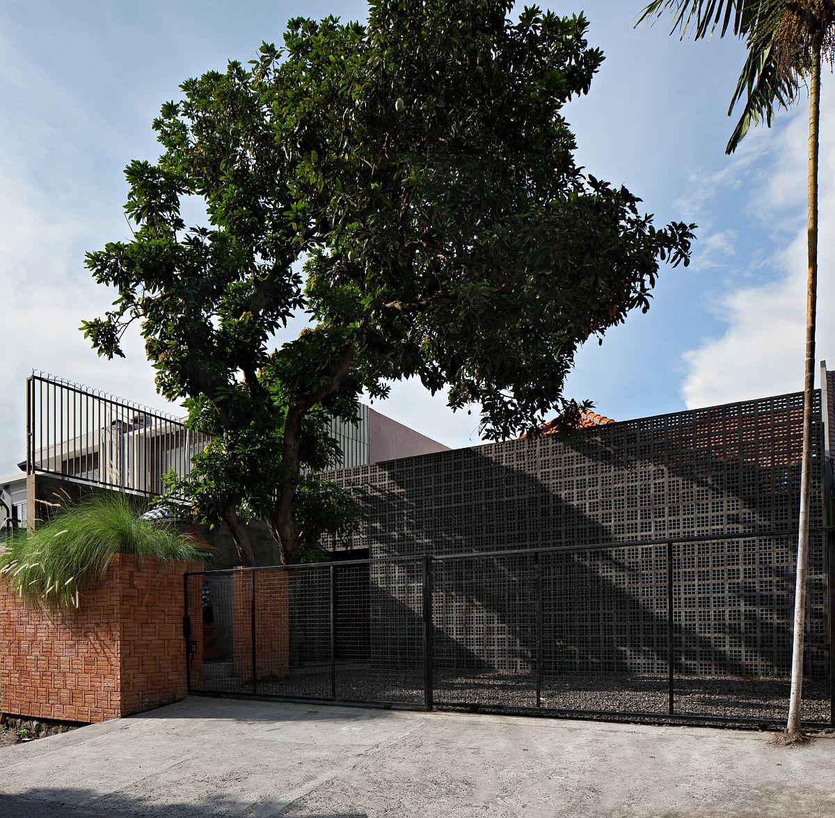 Private street facade of the unique Mandanila House in Bali