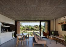 Refined-modern-finishes-are-combined-with-rough-exposed-concrete-inside-the-house-217x155