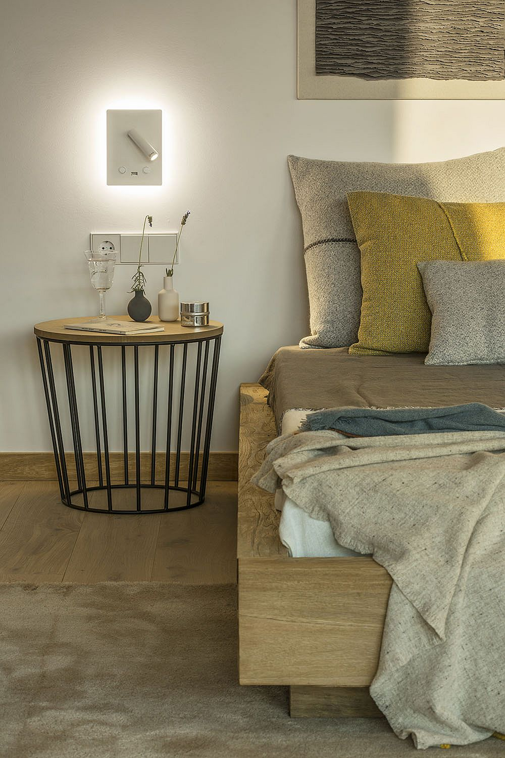 Round modern bedside stand with a metallic base