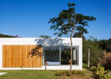 Sliding-window-made-up-of-wooden-slats-offers-privacy-when-needed-217x155