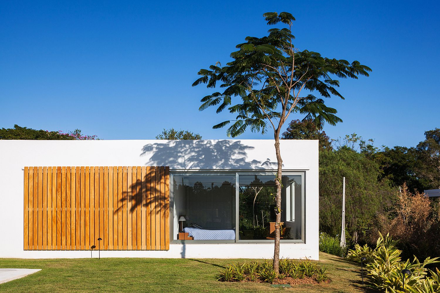 Sliding window made up of wooden slats offers privacy when needed