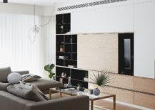 Sliding-wooden-panel-for-the-entertainment-unit-conceals-the-TV-along-with-shelves-next-to-it-217x155