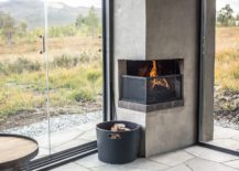 Small-corner-fireplace-is-built-into-the-structure-of-the-cabin-217x155