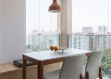 Small-dining-area-in-the-corner-with-wooden-bench-and-wonderful-views-217x155
