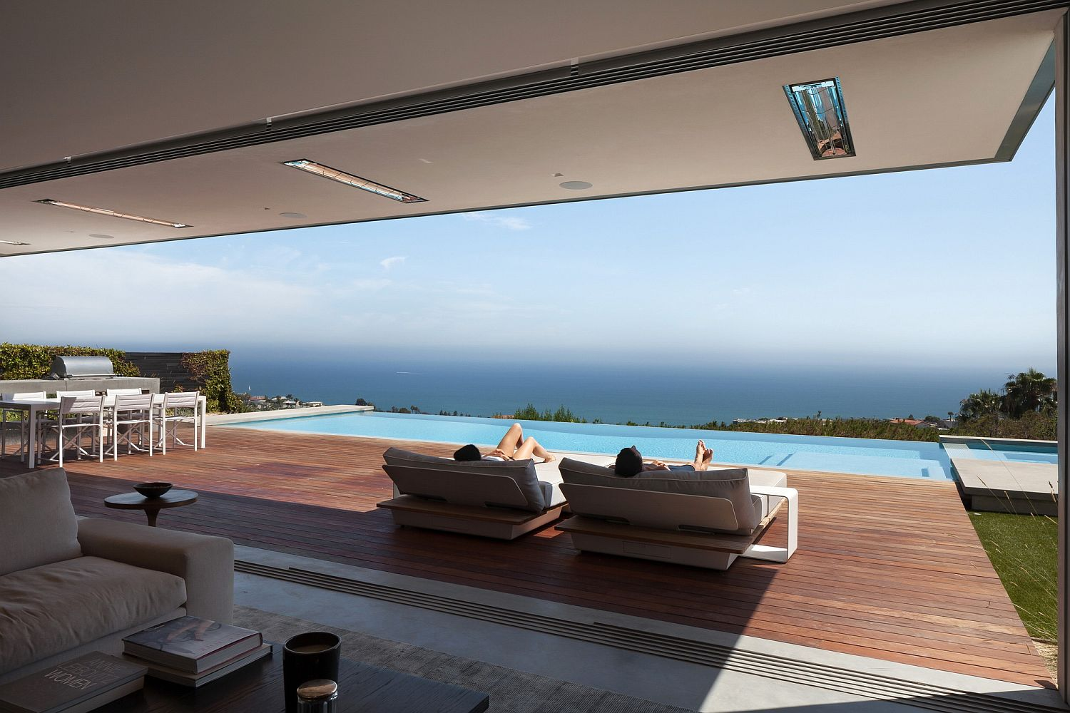 Spacious wooden deck next to the infinity pool overlooking the Pacific Ocean