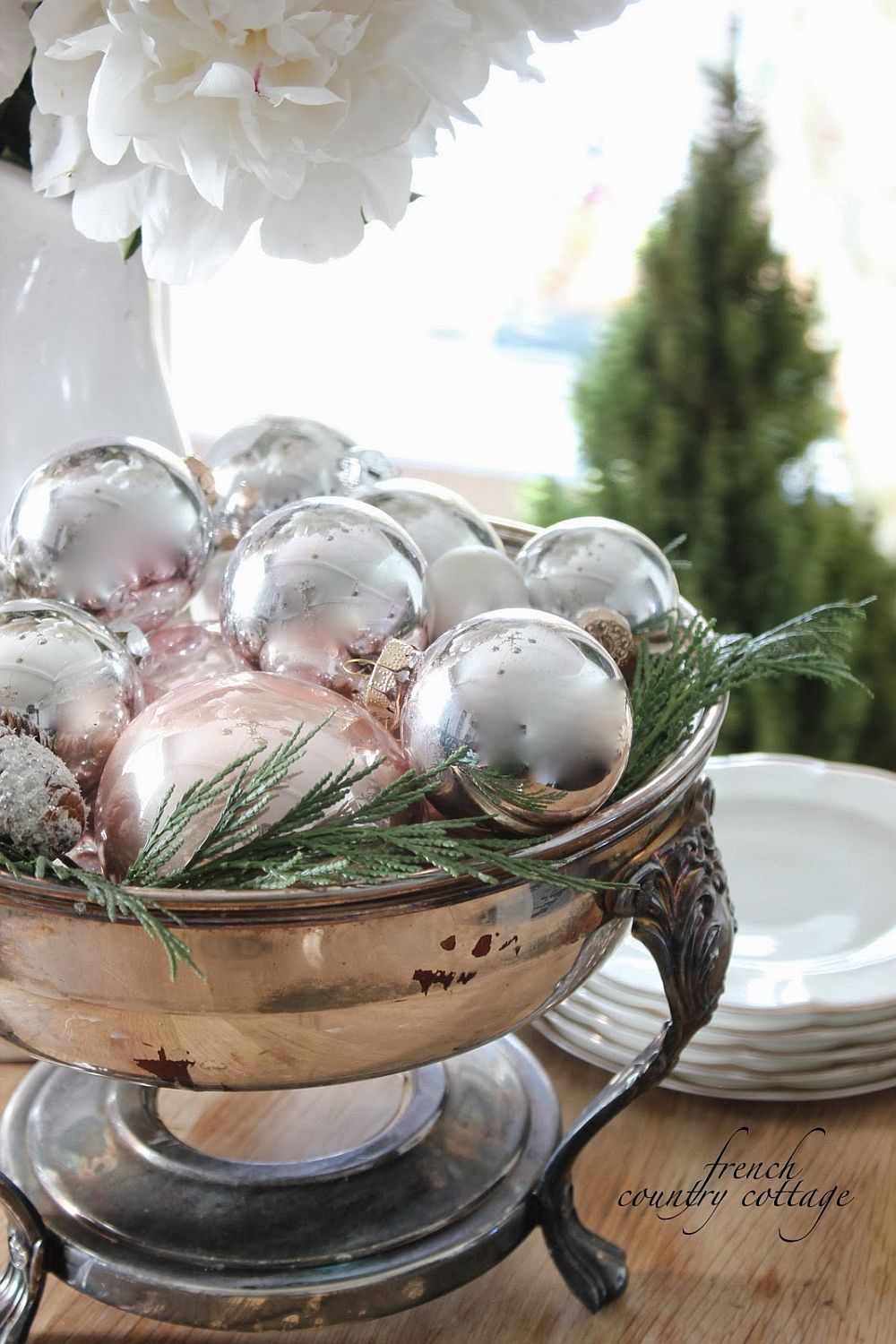 Sparkling Christmas ornaments in a bowl make for an easy decorative piece