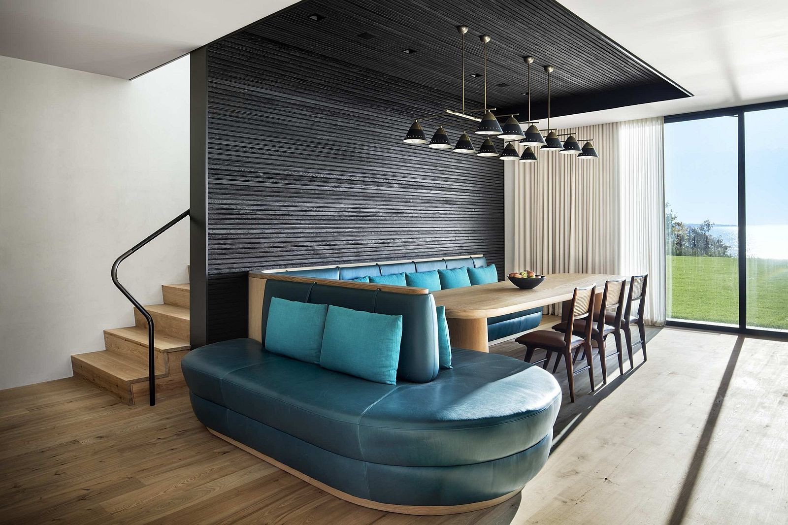 Stunning-banquet-dining-in-turquoise-blue-and-minimal-wooden-table