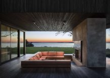 Stunning-outdoor-deck-with-sunken-lounge-and-concrete-fireplace-217x155