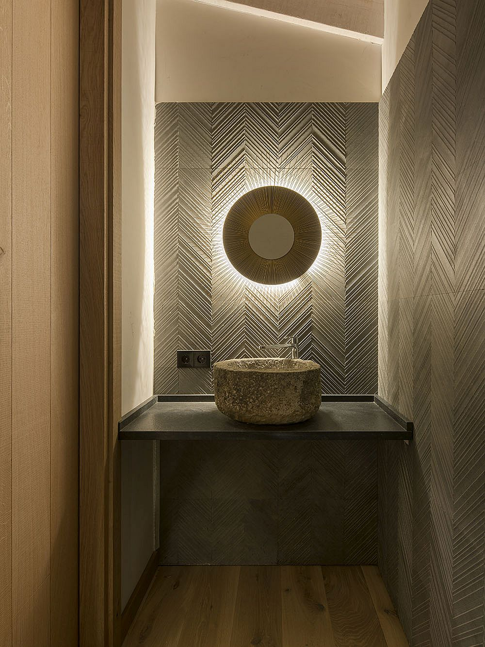 Stunning use of pattern and lighting in the small powder room