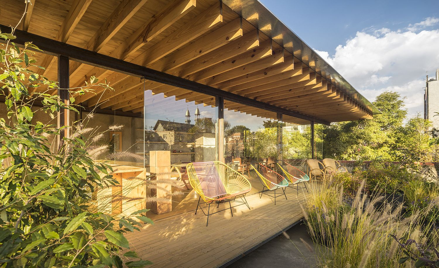 Sweeping deck next to the interior courtyard offers a tranquil sitting area