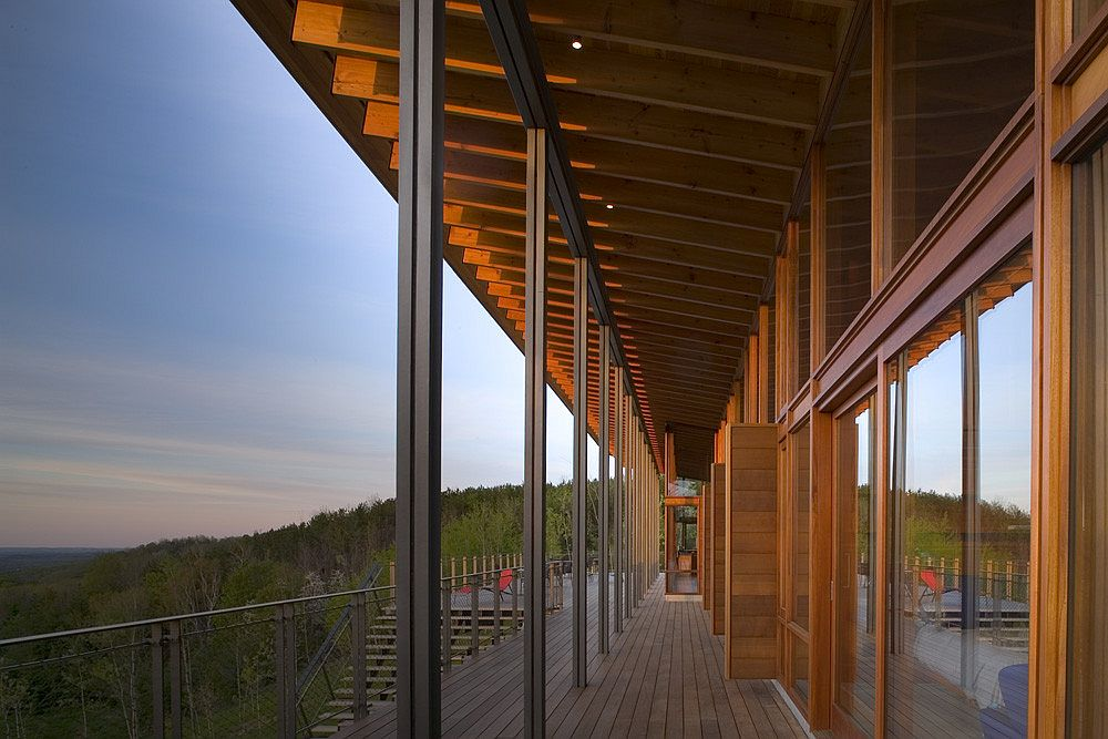 Sweeping wooden deck with a view of majestic evergreen and hardwood forests