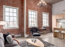 Tall-interiors-give-the-modern-industrial-apartment-a-visually-spacious-and-cheerful-ambiance-217x155